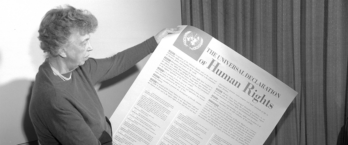 Mrs. Eleanor Roosevelt of the United States, chair of the drafting committee, holding a Universal Declaration of Human Rights poster in English. UN Photo (1949)