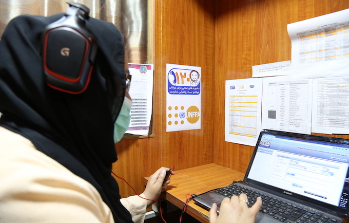 A Youth Health Line counsellor provides guidance on health issues, including child marriage, to young people in Afghanistan | Image: Zaeem Abdul Rahman/UNFPA Afghanistan