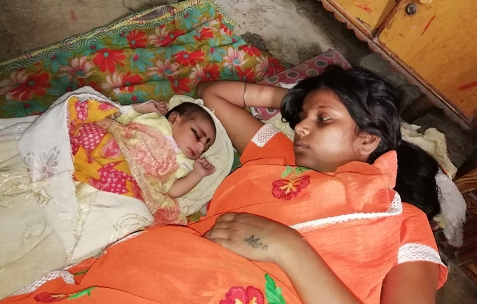 Woman lying next to her daughter.