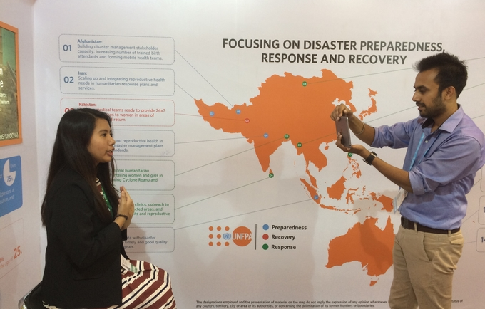 Chloe Reynaldo being interviewed at the UNFPA AMCDRR stall