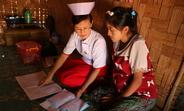 Midwife Nan Mya Phyu discusses family planning with Nan Aye Aye Han in Nam Khoke Village, Shan State, Myanmar