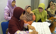 Women work as part of a violence against women data collection training