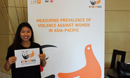 A woman shows her support of the kNOwVAWdata initiative at its launch event