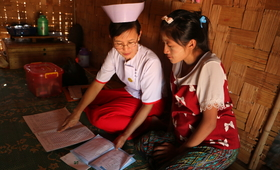 Midwife Nan Mya Phyu discusses family planning with Nan Aye Aye Han in Nam Khoke Village, Shan State, Myanmar