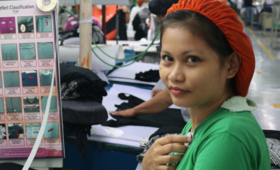 Mae Esparcia an employee at Hamlin's garments factory.  (Photo by UNFPA Philippines) Mae Esparcia, an employee at Hamlin's garments factory in Cavite, the Philippines is now better to her family and life.  (Photo by UNFPA)