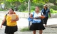 Women walk together in the Marshall Islands